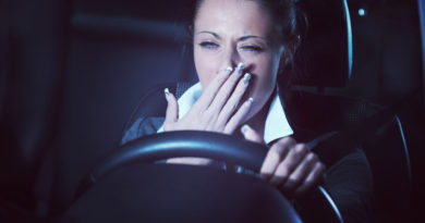Distracted exhausted tired woman driving a car late at night. drowsy driving