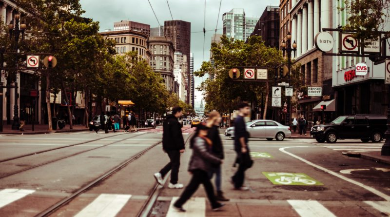 people crossing the street vi pedestrian lane