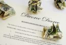 divorce document with crumpled dollar bills