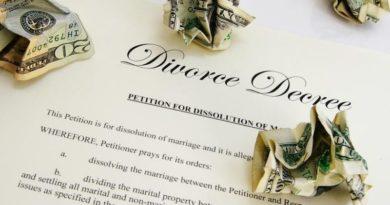 divorce document with crumpled dollar bills