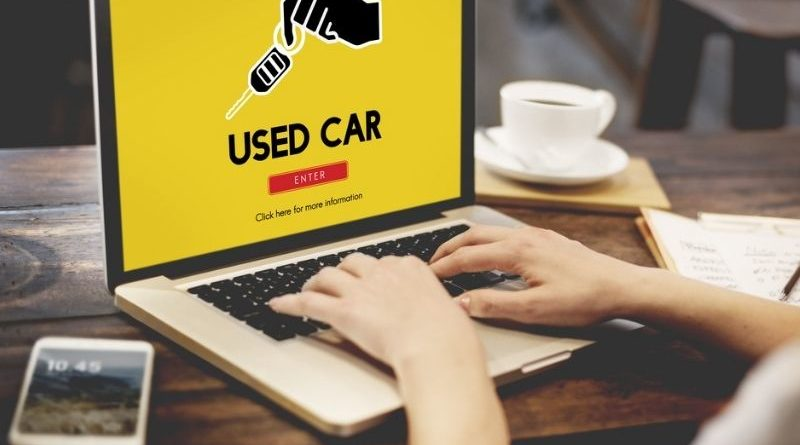 used car on computer monitor