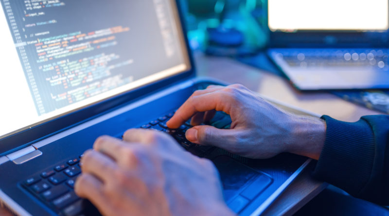 Hacker trying to get past cybersecurity in healthcare